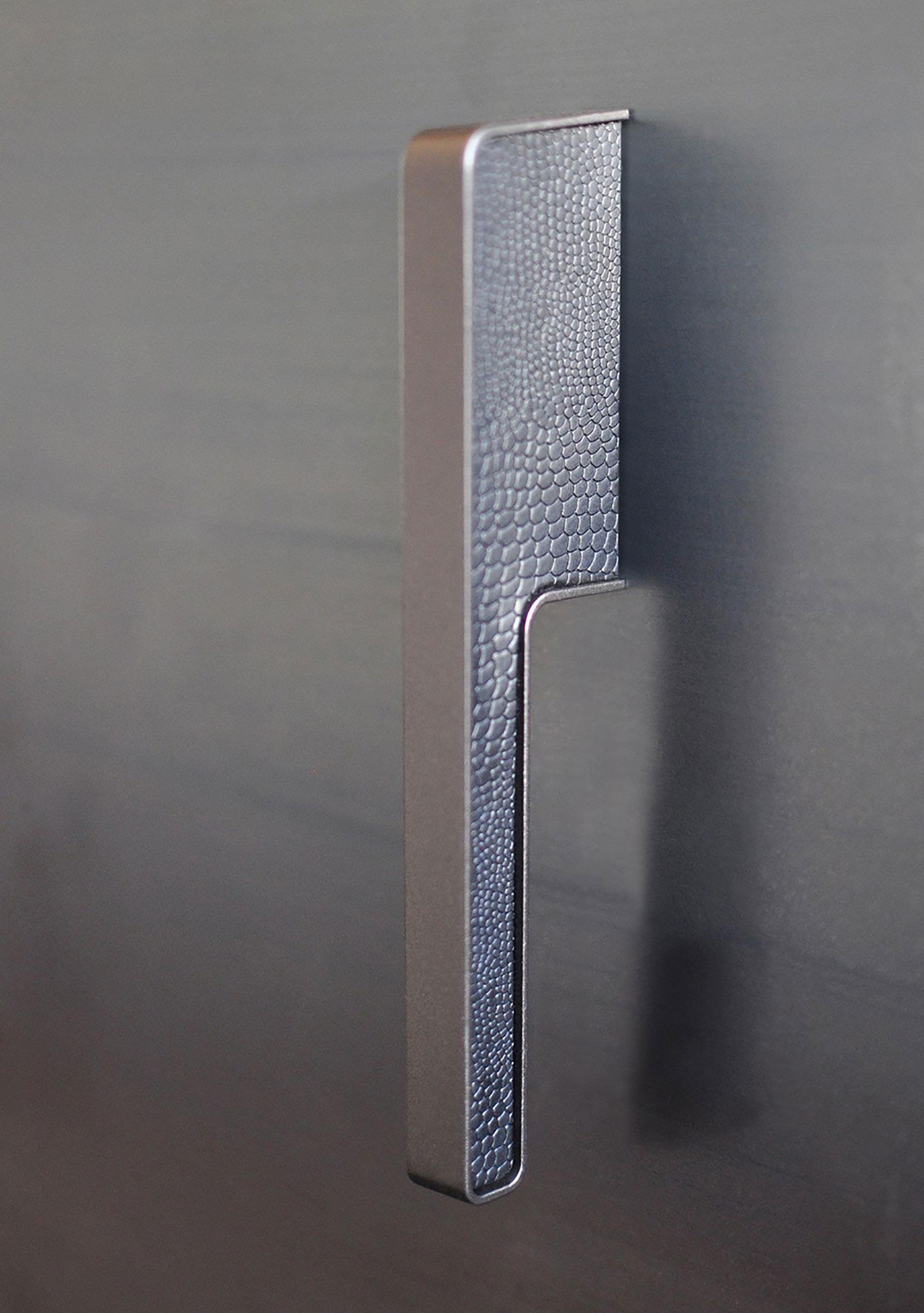 Griff Elliot von Haefele. Entwurf von JOI-Design.