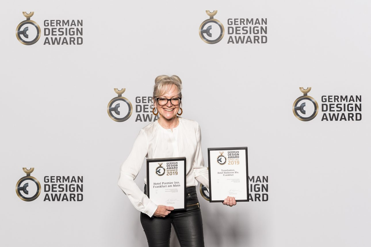 "Corinna Kretschmar-Joehnk with the two awards from the ""German Design Award 2019"""